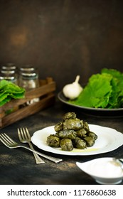 Azerbaijani cuisine dolma, grape leaves stuffed with meat and rice and spices, served with Greek yogurt, national cuisine, family traditonal recipe, copy space