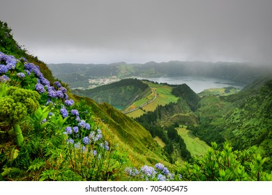Azores islands. Panoramic landscape overlooking three amazing ponds, Lagoa de Santiago, Rasa and lagoa Azul, Lagoa Seven Cities.The Azores are one of the main tourist destinations in Portugal