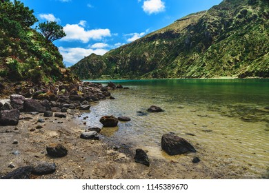 Azores, Portugal. Beautiful lake lagoa do Fogo among the mountains on San Miguel Island in a sunny day