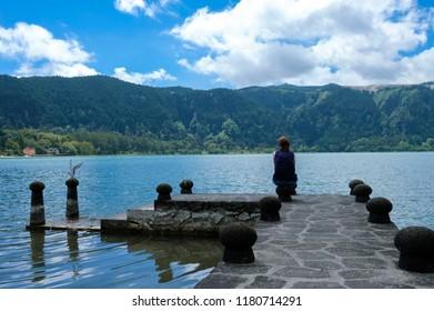 Azores, young woman over looking Furnas Valley, Lagoon Furnas (Lagoa das Furnas), Sao Miguel Island, Azores