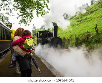 AZPEITIA, SPAIN - APRIL 28, 2018: Steam train arrival. Attraction for kids and parents at railway museum.