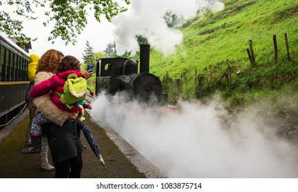 AZPEITIA, SPAIN - AVRIL 28, 2018: Steam train arrival. Attraction for kids and parents at railway museum.