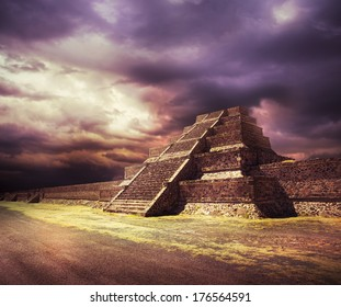 Aztec pyramid at sunset with dramatic sky, Not a real place, just a representation of ancient Mexico using parts of an actual pyramid to make the composite