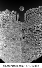 Aztec Ruins with moon in northwest New Mexico were actually built by the Anasazi.