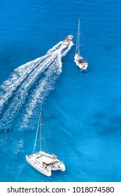 Azure bay with yachts in Greek sea.