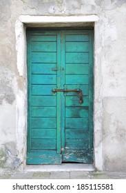 Azure door in the island of Giudecca in Venice