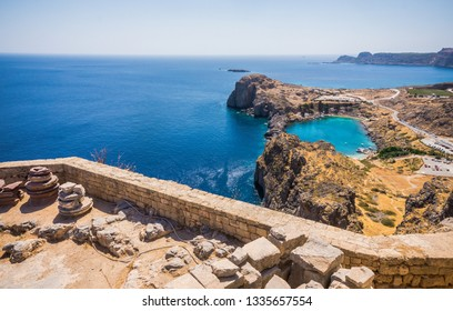 Azure heart shaped sea bay in Lindos, Rhodes, Greece. Beautiful blue St Paul's bay near Acropolis of Lindos