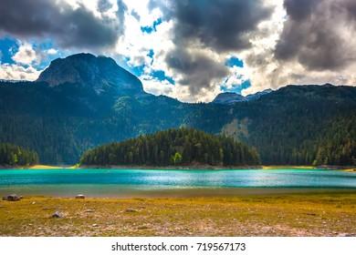 Azure lake on the background of mountains Bobotov Kuk. Black Lake. Durmitor National Park. Montenegro.