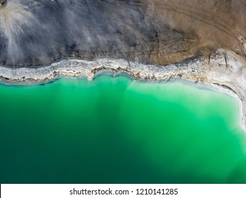 Azure lake top view, abstract fantasy green and brown pattern background