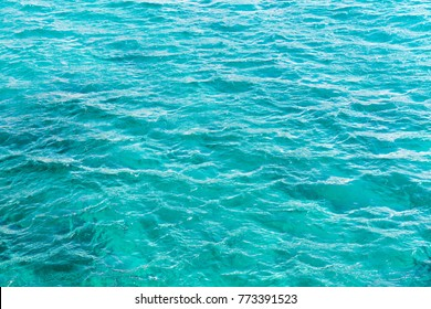 Azure ocean water surface, natural background photo texture