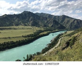 The azure river near mountains, Altai