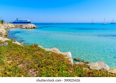 Azure sea bay in Ile Rousse coastal town, Corsica island, France