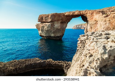 Azure Window, famous stone arch of Gozo island in the sun in summer, Malta.