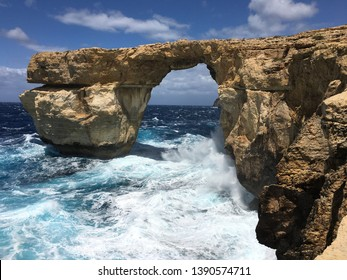 Azure window in the form of a natural arch of limestone rock in the Mediterranean Sea on the island of Gozo Malta.