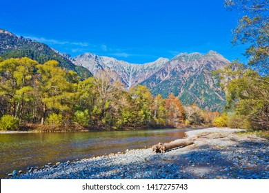 Azusa River flowing through Kamikochi national park in Nagano Prefecture, Japan. The autumn leaves season is beautiful.
