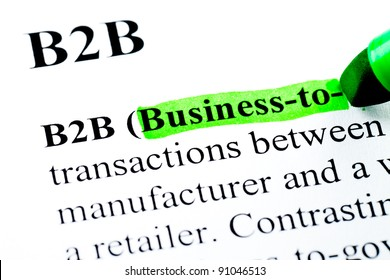B2B Business to business definition highlighted by green marker on white paper background