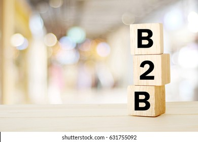 B2B , business to business marketing, business word on wooden cubes over blur background, banner, with copy space for text