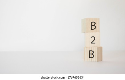 B2B written in a wooden cube on a white background