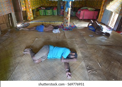 BA, FIJI -  DEC 30 2016:Indigenous Fijian men sleeping on the floor after drinking lots of Kava. Some of the side effects of kava are headache, dizziness, drowsiness, depression and sleepiness.