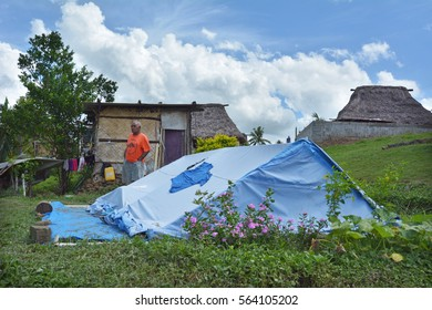 BA, FIJI -  DEC 30 2016:Victim of Cyclone Winston live in UNICEF tent in Navala village. Fiji struggles to rebuild a year after Cyclone Winston tropical storm devastated the country on February 2016.
