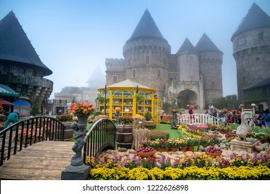 Ba Na Hill mountain resort, Danang city, Vietnam - October 19, 2018: Many tourists on European style streets in Ba Na Hills Mountain Resort with amusement rides, attractions, restaurants...