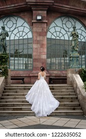 Ba Na Hill mountain resort, Danang city, Vietnam - October 19, 2018:  The bride in a chic wedding dress on the stairs at Ba Na Hill mountain resort. This place is a favorite destination of many touris