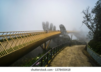 Ba Na Hill mountain resort, Danang city, Vietnam. The Golden Bridge is lifted by two giant hands in the tourist resort on Ba Na Hill in a foggy day at Danang, Vietnam.