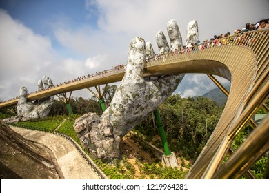Ba Na Hills. Da Nang, Vietnam -  October 24 2018: The Golden Bridge is lifted by two giant hands in the tourist resort on Ba Na Hills in Da Nang, Vietnam.