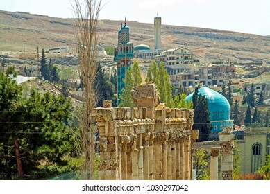 Baalbek, Baalbek-Hermel Governorate, Lebanon - 4.7.2004 Two thousand years of history in one photograph - Roman Temples, Islamic Mosques and Modern Lebanese buildings - at Baalbek - formerly Heliopolis.
