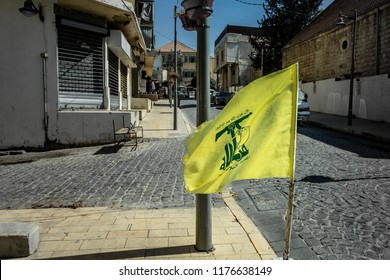 Baalbek, Lebanon - October 3 2017: Flag of the terrorist organization and political party Hezbollah is waving on the streets of Baalbek in eastern Lebanon.