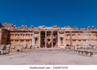 BAALBEK / LEBANON / SEPTEMBER 26, 2017: Ancient Roman temple of Bacchus with surrounding ruins with blue sky in the background, Bekaa Valley, Baalbek, Lebanon