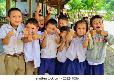 BAAN MAE- OR , MAE CHAEM, CHIANGMAI, THAILAND, JUNE 10 : Unidentified Karen ethnic kids are showing thumbs up sign at their primary school  on June 10,2014 Mae chaem,Chiangmai,Thailand