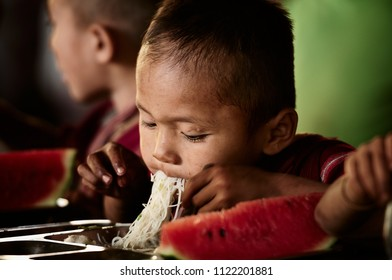 Baan Mae Lana village, Thasongyang district, Tak province,Thailand - December 05,2014 : Feeling of unidentified children eating the lunch in canteen of school, low key.