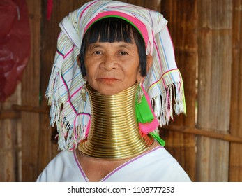 BAAN PAOO NANGLAE, CHIANG RAI / THAILAND - NOV 4, 2015: Dignified elderly Karen long-neck woman wears traditional brass neck coils and poses for the camera, on Nov 4, 2015.