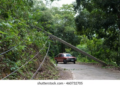 BAAN POK, CHIANGMAI THAILAND - JUL 10 :  The electrical pole down and block the road due to storm, the tree hit the electrical wire beside the road to Baan Pok village, Chiang mai on Jul 10, 2016.