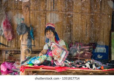 Baan Tong Luang Chiang Mai Thailand April 16 2018 Long Neck Karen Woman folds her merchandise due to rain storm