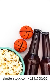Baasketball match party. Beer bottle with basketball and popcorn