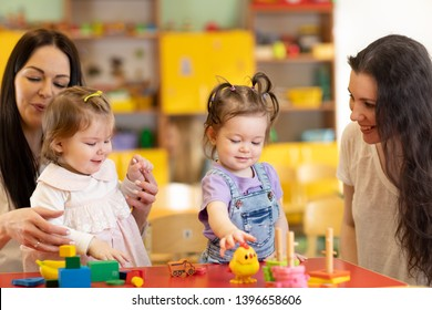 Babies play and their mothers communicate in playroom in day care