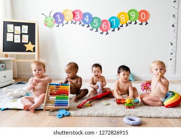 Babies playing together in a play room