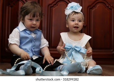 babies in the suit boy and girl twins
