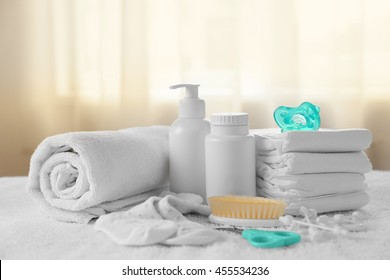 Baby accessories for hygiene on towel