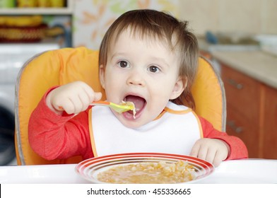baby age of 16 months eating soup