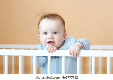 baby age of 8 months in white bed