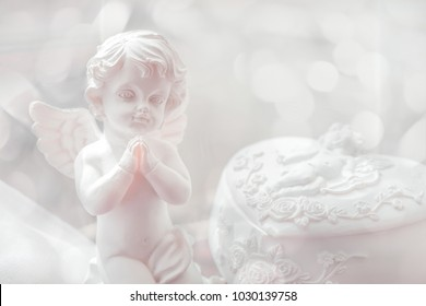Baby angel statuette folding hands to  pray