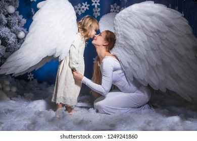 baby angels in fairy tale decoration of christmas background winter story