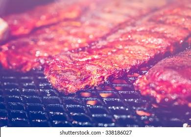 Baby back ribs prepared in smoker.