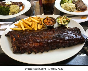 Baby back spare ribs served with french fries and some Cole slaw. Shot at a restaurant in Prague.