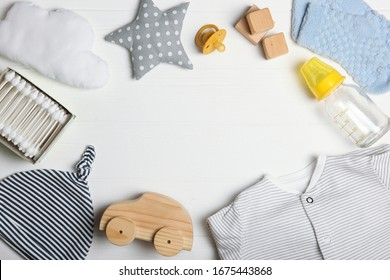 Baby background. Clothing and accessories for a baby on a colored background top view. A place to insert text, minimalism.