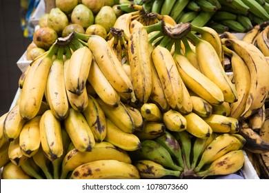 """Baby bananas, or """"oritos"""", type of South American plantain, in Ecuadorian street market."""