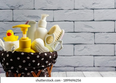 baby bath accessories, baby care concept, yellow rubber duck, ear sticks, shampoos, soap.children's hygiene